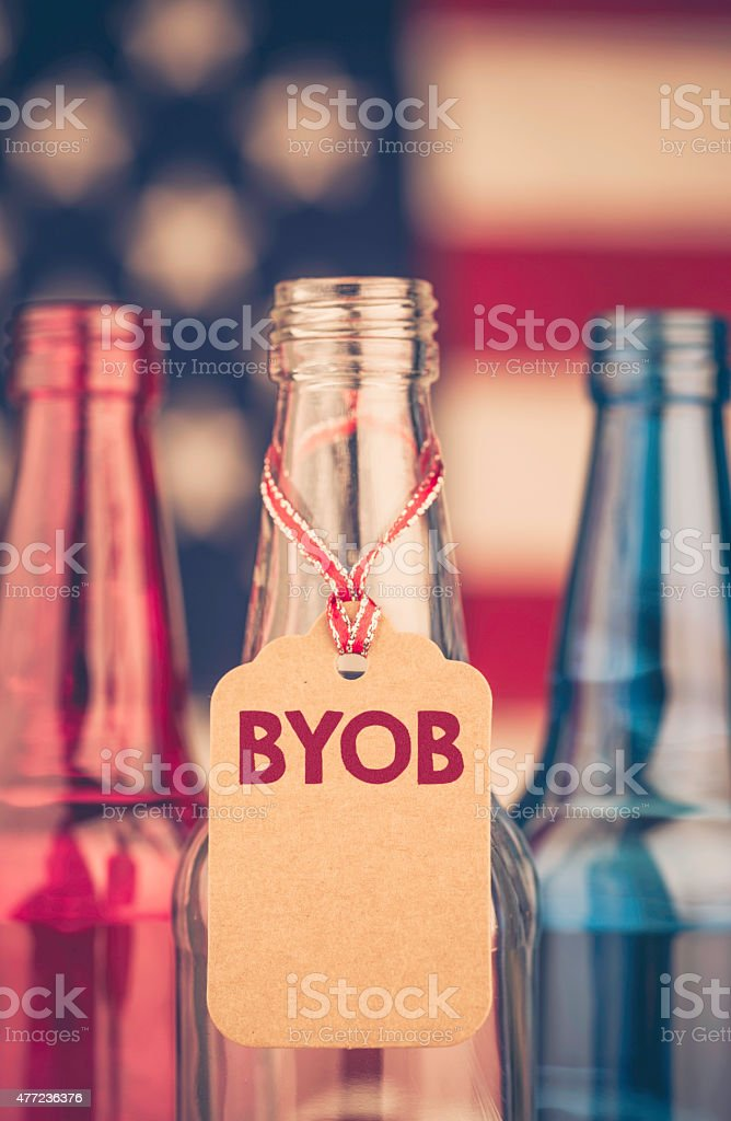Red, white and blue beer bottles with party message: BYOB stock photo