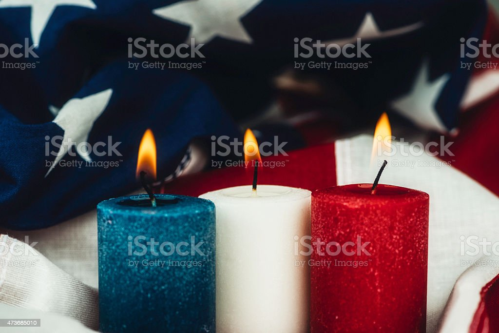 Red, white and blue candles to commemorate US Memorial Day stock photo