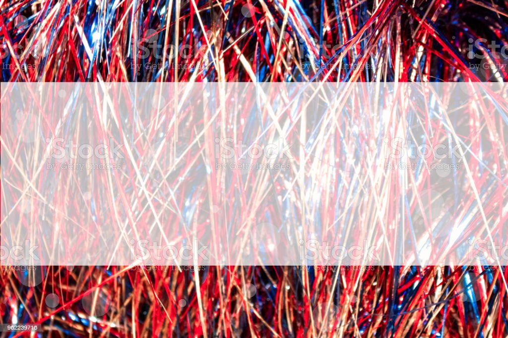 Red white and blue cellophane tinsel strips background with bokeh with semitransparent panel for copy stock photo