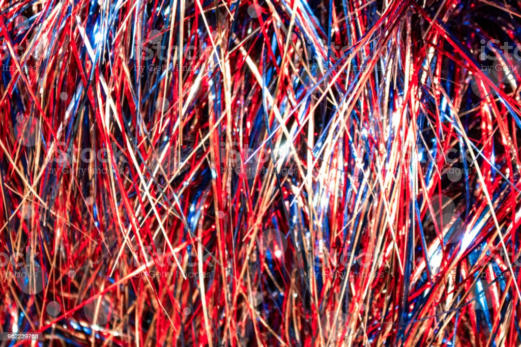 Red white and blue cellophane tinsel strips background with bokeh stock photo