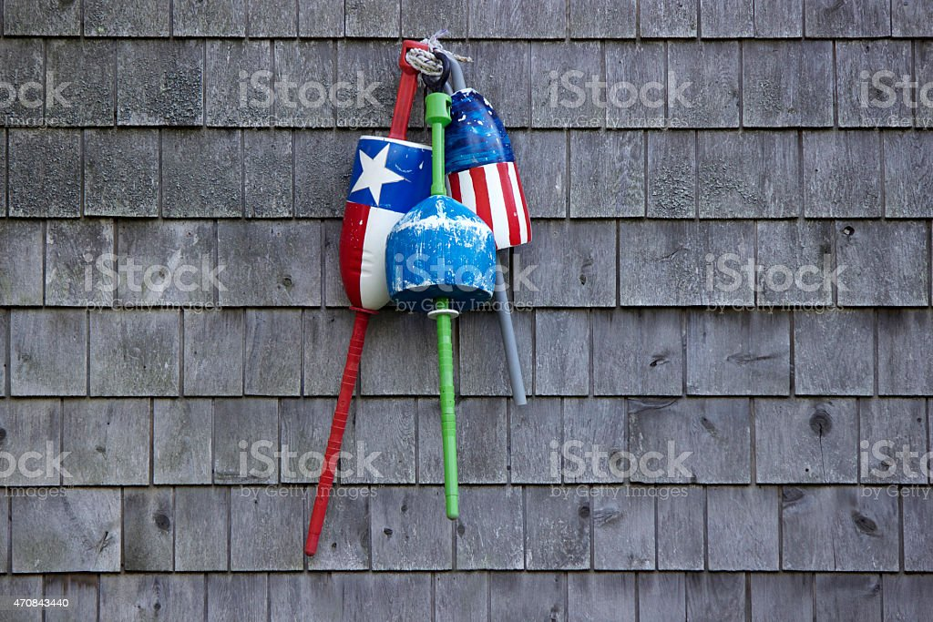 Red, White and Blue Fishing Floats stock photo