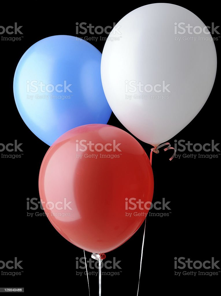 Red, White and Blue Helium Balloons Isolated on Black Background royalty-free stock photo
