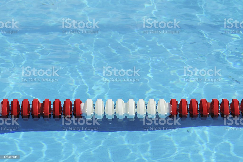 red white and blue olympic size swimming pool lane marker royalty free stock photo