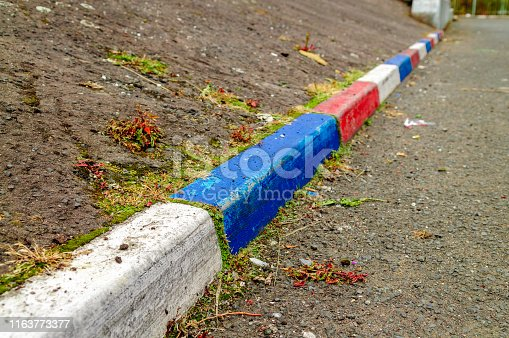 Red, white and blue painted kerb stones in a Belfast street