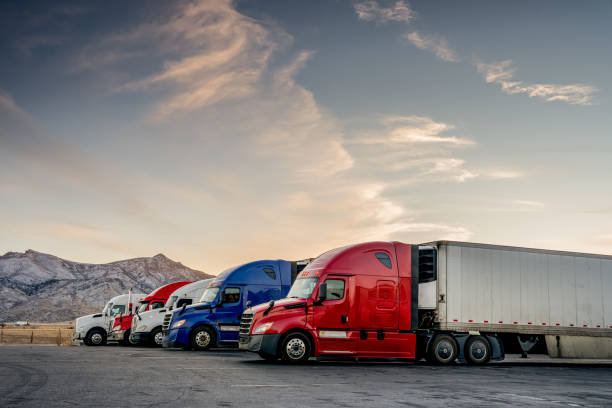 Red White and Blue Parked Trucks Lined up at a Truck Stop stock photo