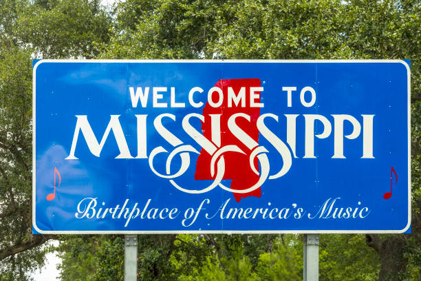 Red, white, and blue sign to welcome travelers to Mississippi - Birthplace of America's Music at Chef Menteur Hwy stock photo