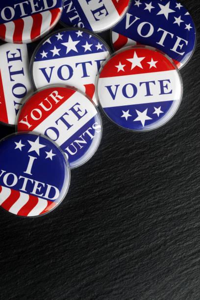 red, white, and blue vote buttons background - выборы президента стоковые фото и изображения