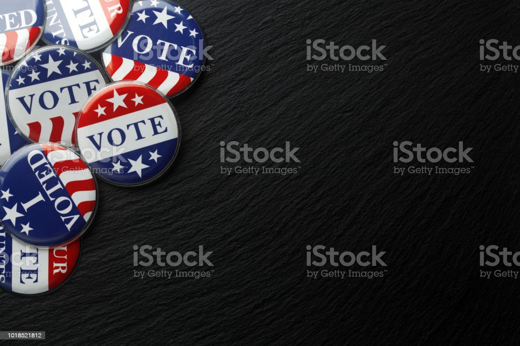 Red, white, and blue vote buttons background stock photo