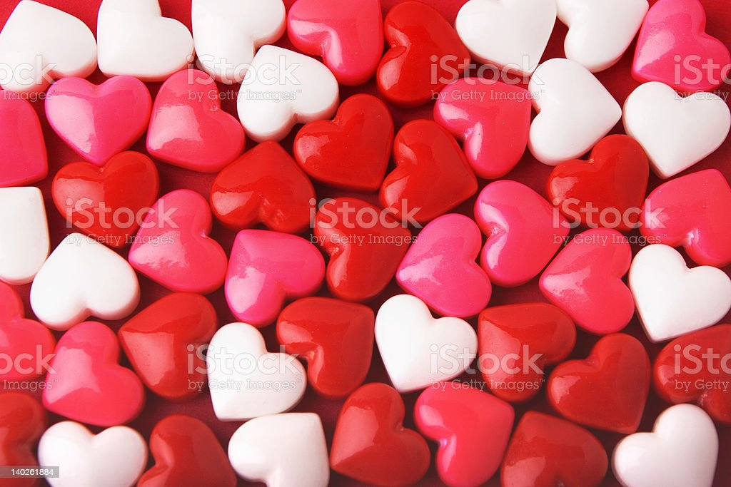 Red, white, and pink candy hearts background stock photo