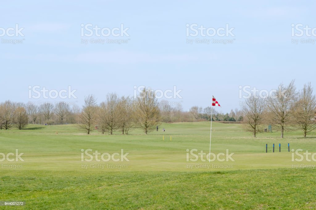 red white checkered flag on the golf course stock photo