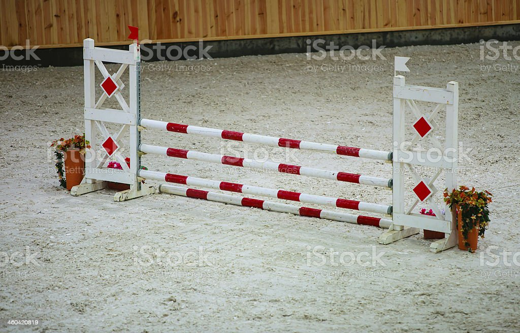 Red white obstacle for jumping horses. Riding competition. stock photo