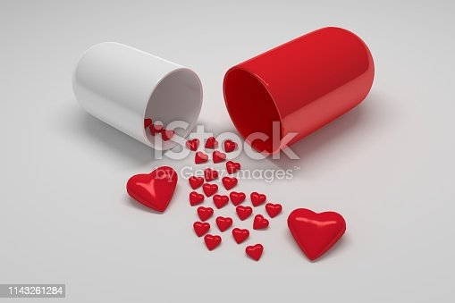 istock Red white pill capsule with many small hearts 1143261284