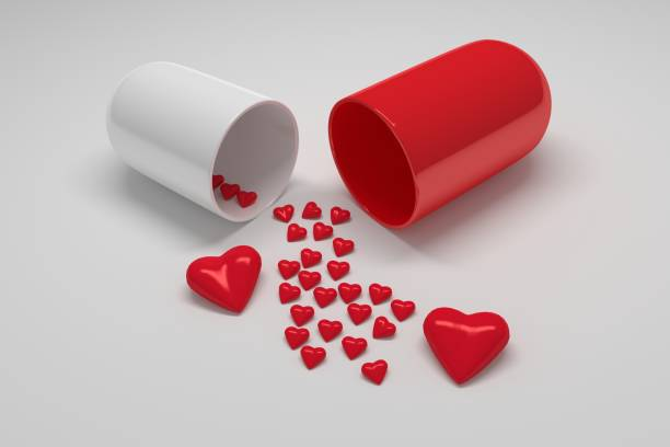 Red white pill capsule with many small hearts stock photo