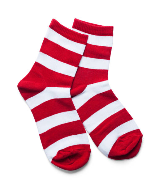 Red White Striped Socks Two Red and White Striped Socks Isolated on White. sock stock pictures, royalty-free photos & images