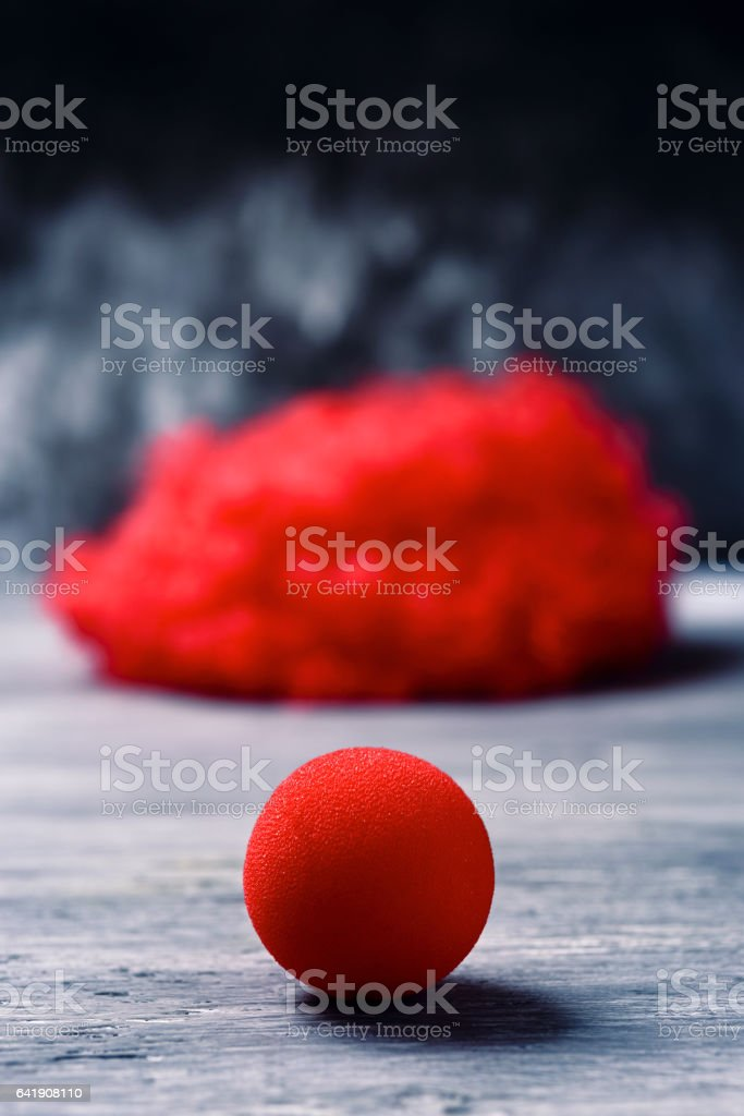 red wig and red clown nose stock photo