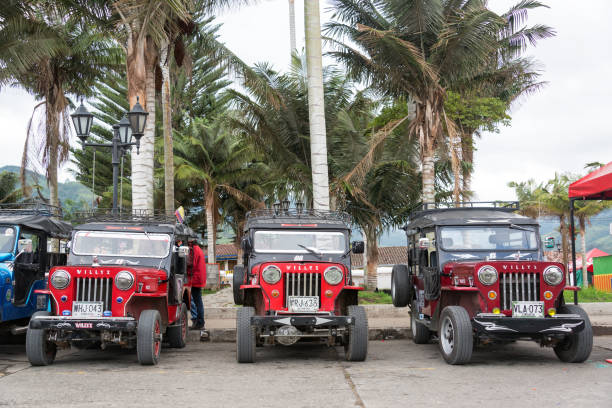 Red Willys Jeeps in Colombia SALENTO, COLOMBIA - JUNE 6: Row of red Willys Jeeps in Salento, Colombia on June 6, 2016 willys stock pictures, royalty-free photos & images