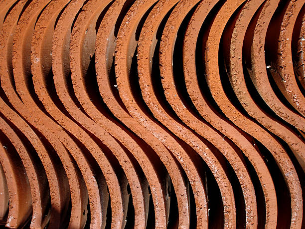 red winding clay structure - deviate stock pictures, royalty-free photos & images