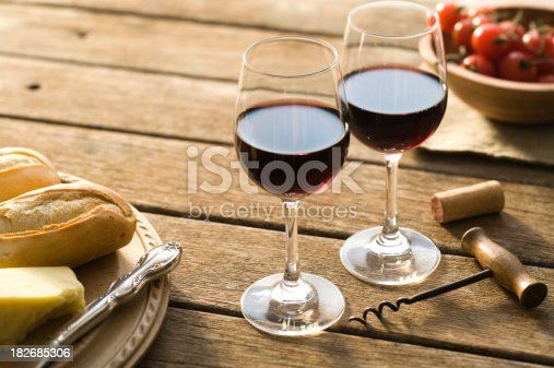 Red wine on picnic table on a summer's late afternoon.