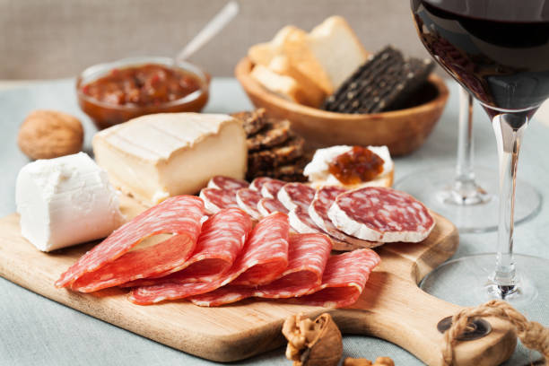 Red wine and charcuterie assortment stock photo