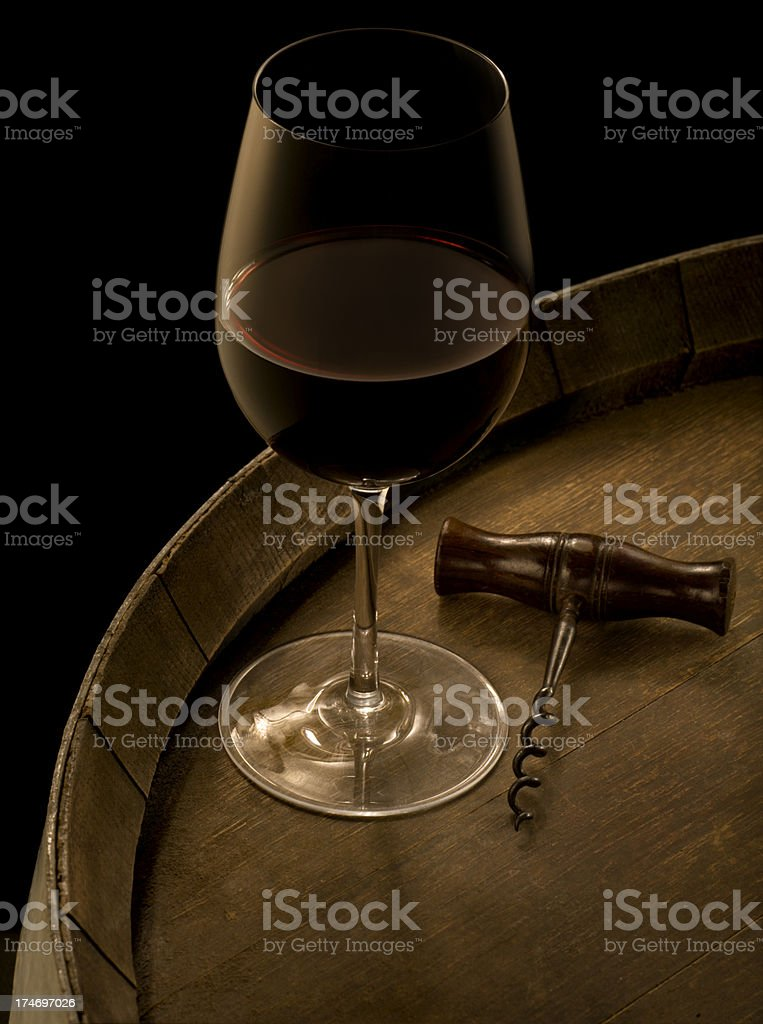 Red Wine and Corkscrew on Barrel royalty-free stock photo