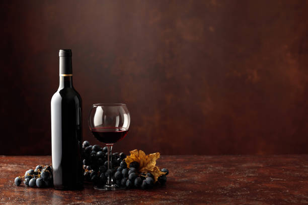 Red wine and grapes on a brown background. stock photo