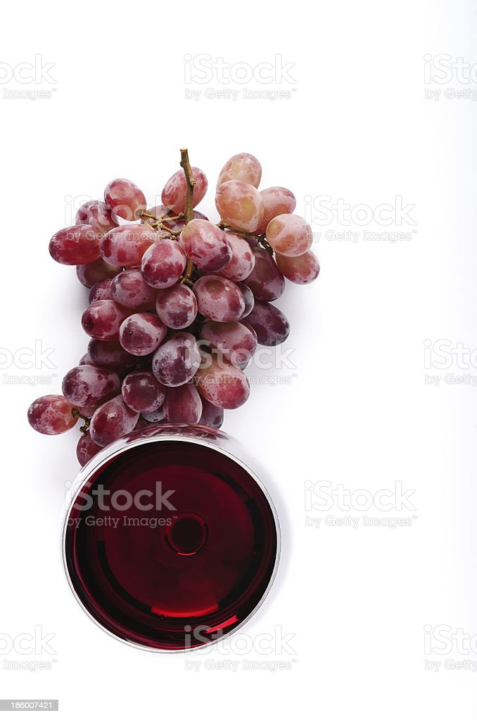Red wine and grapes overhead on white royalty-free stock photo