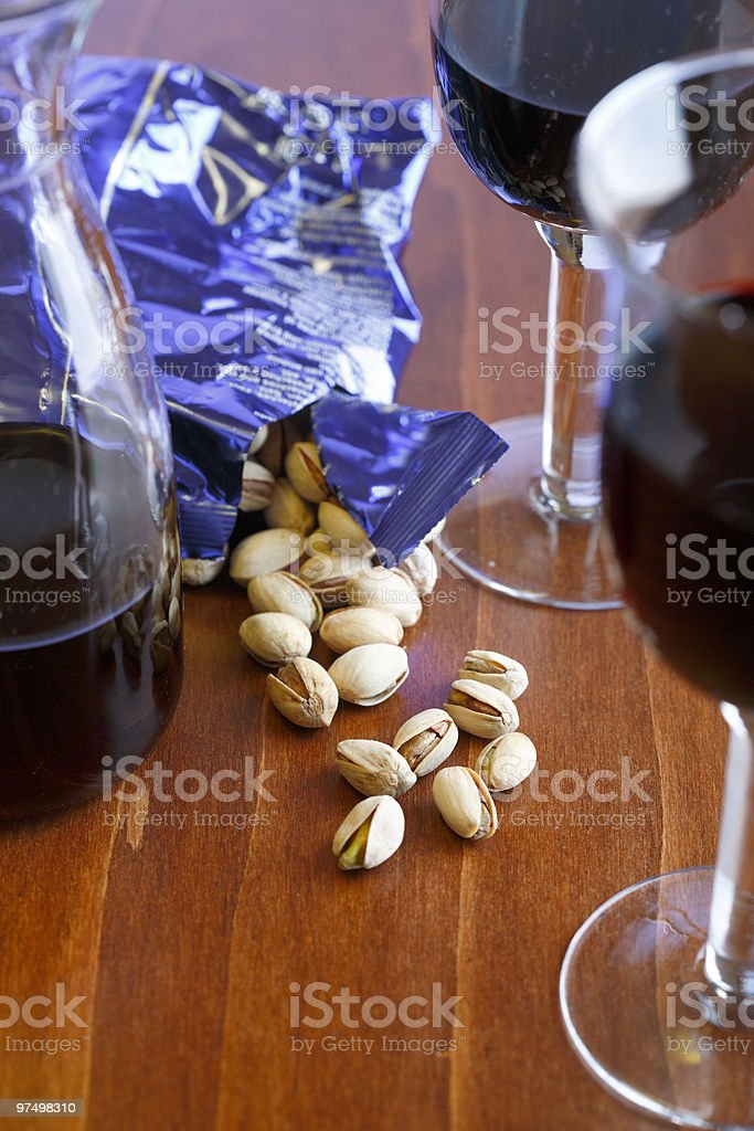 red wine and pistachios royalty-free stock photo