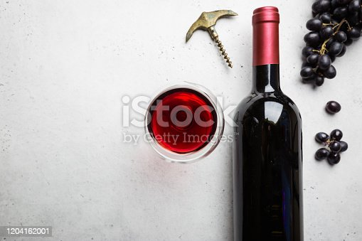 istock Red wine and ripe grapes 1204162001