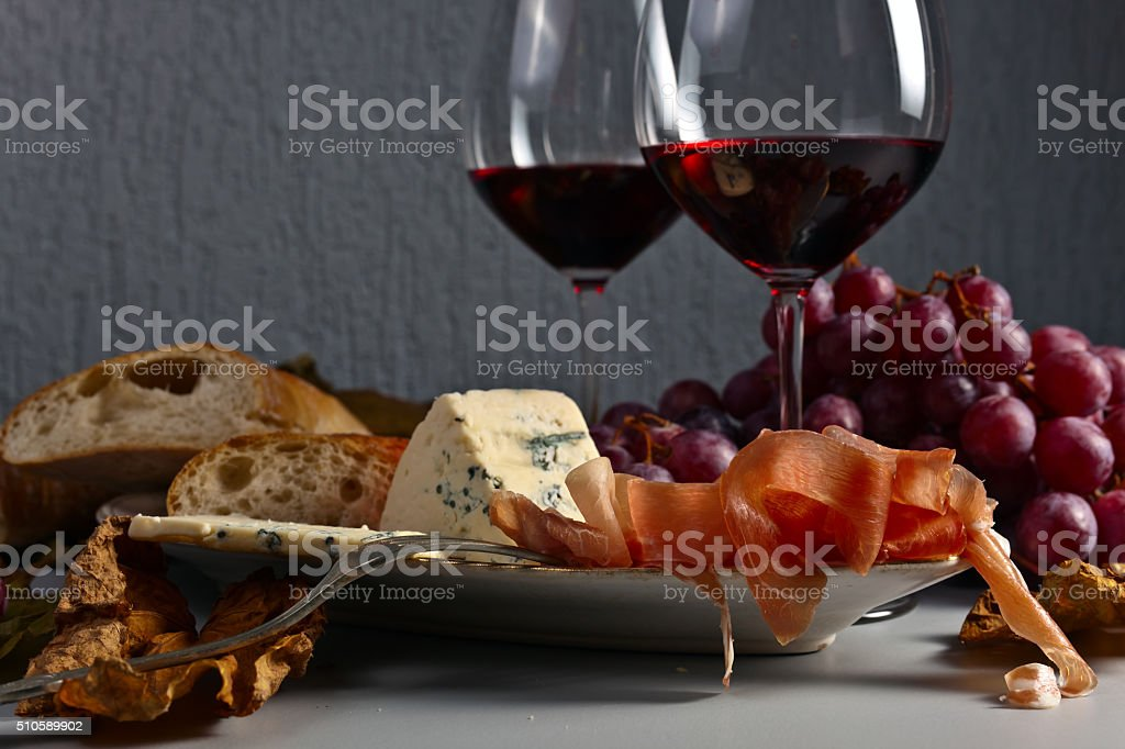 red wine and snacks stock photo