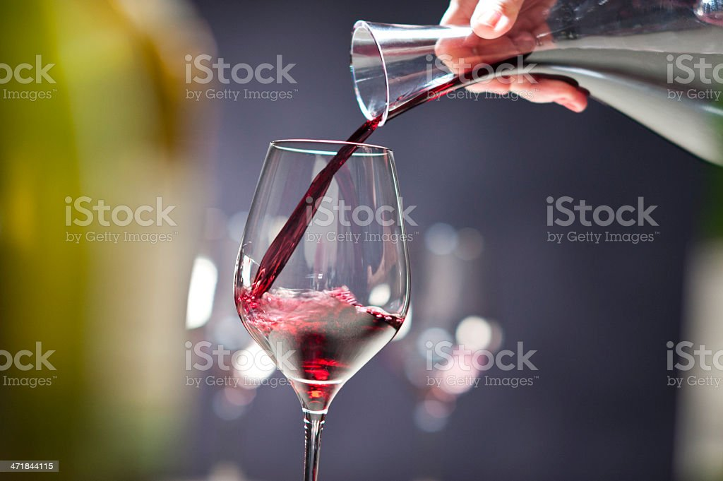 Red wine being poured from a wine carafe royalty-free stock photo