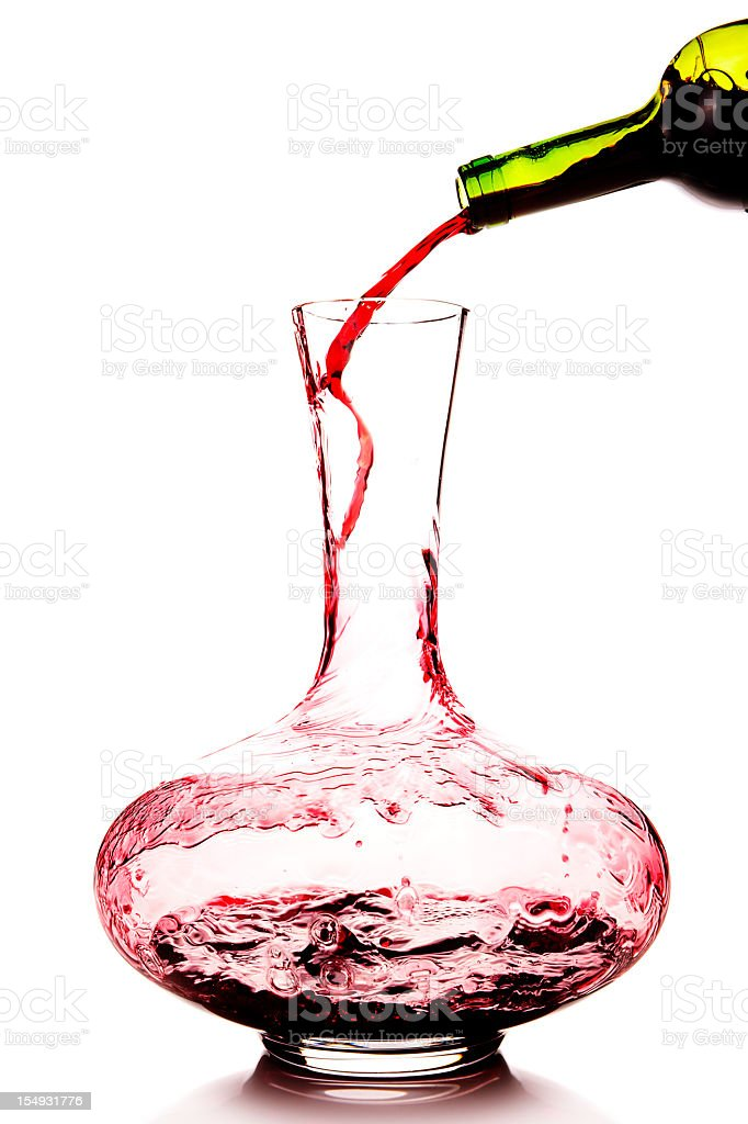 Red wine being poured in a decanter stock photo