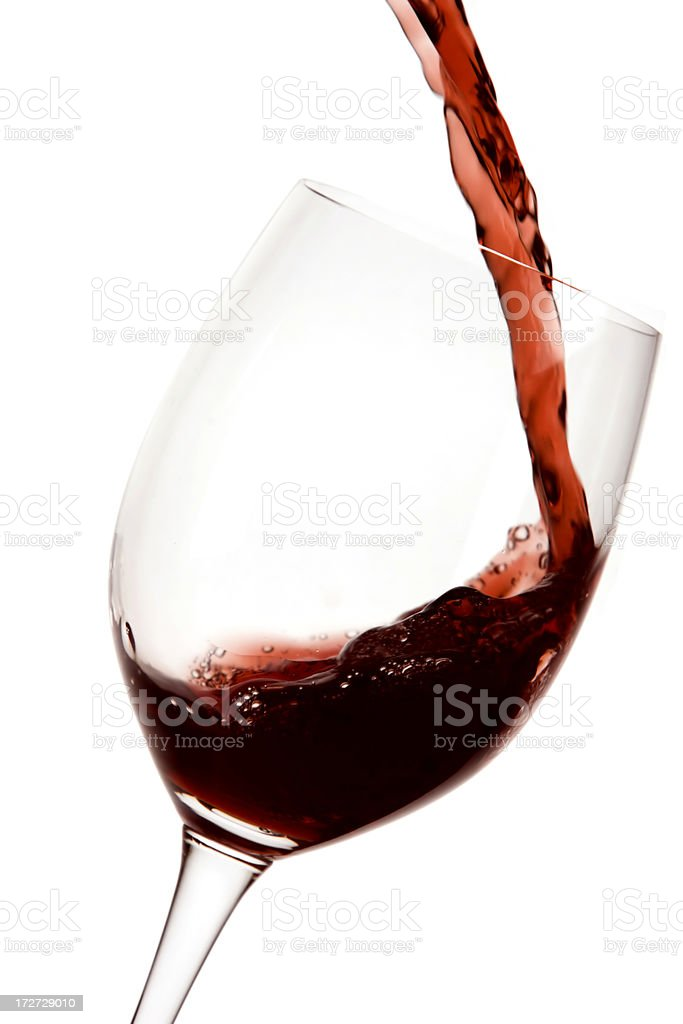 Red wine being poured in a glass royalty-free stock photo