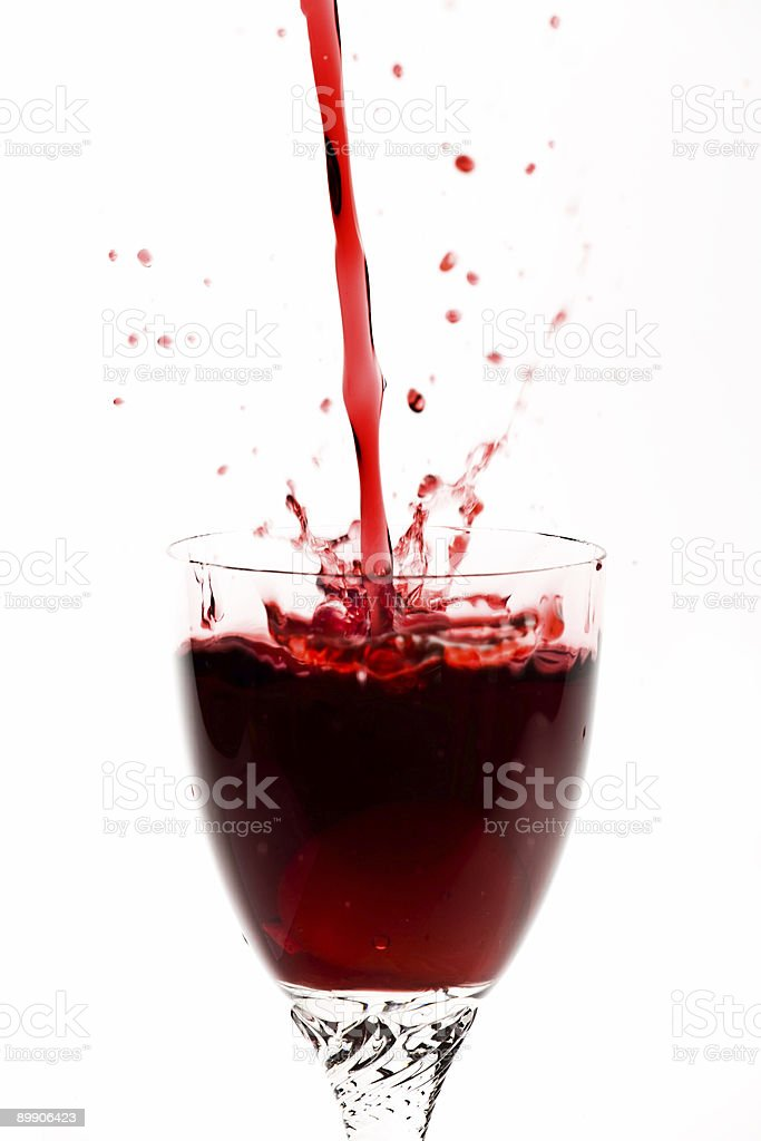 Red wine being poured into glass royalty-free stock photo