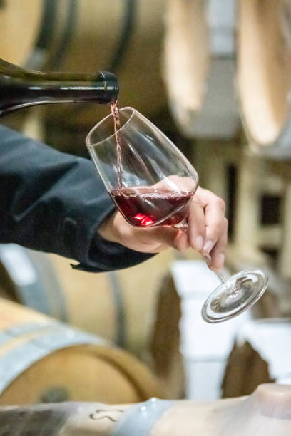 Red wine being poured out of a bottle stock photo