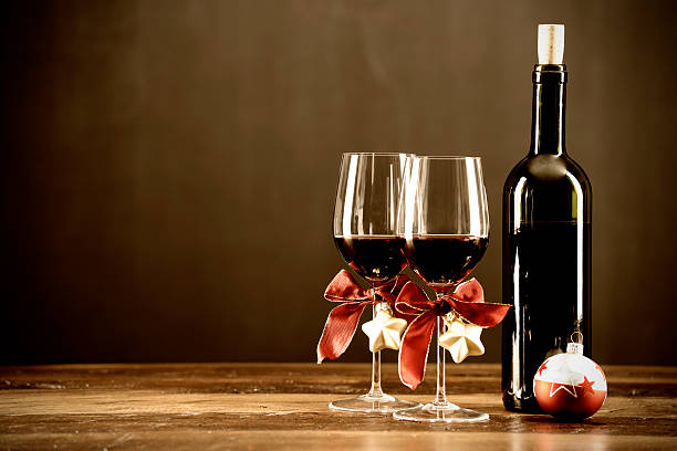 Red wine, bottle and christmas baubel stock photo