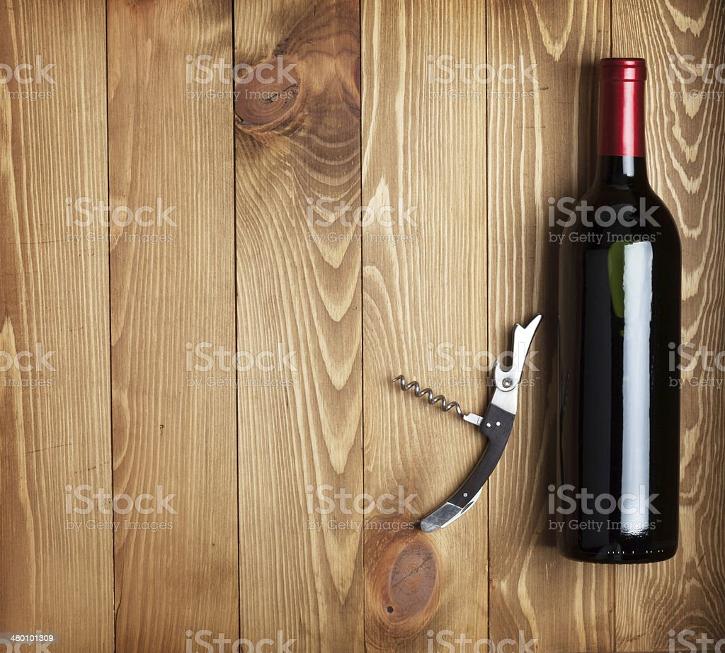 Red wine bottle and corkscrew stock photo