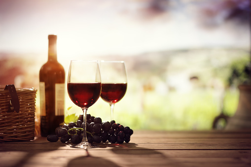 istock Red wine bottle and glass on table in vineyard Tuscany Italy 912129788