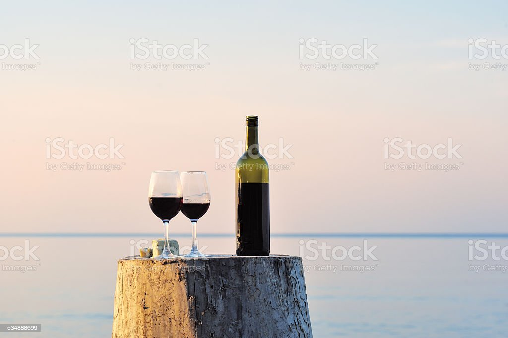 Red wine bottle and wine glasses stock photo