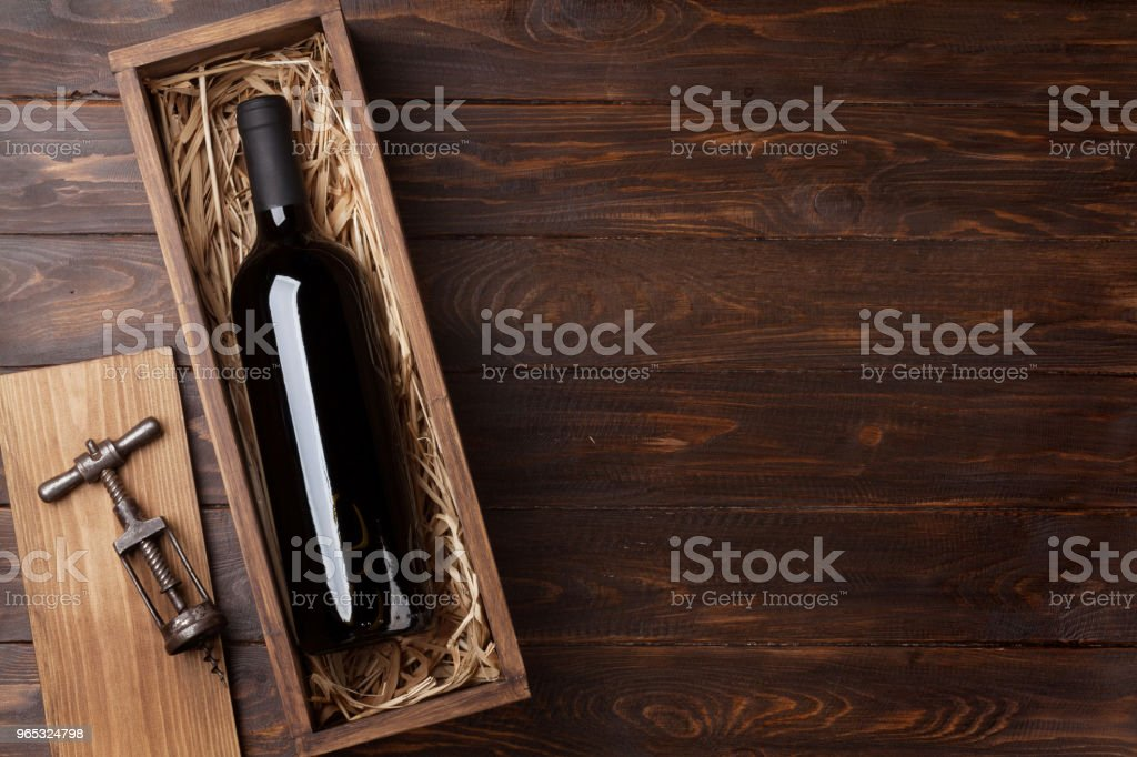 Red wine bottle in box stock photo
