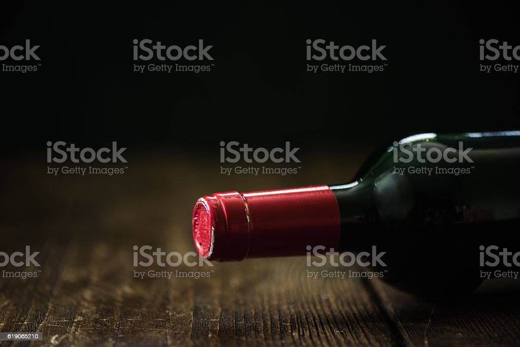 red wine bottle on wooden talbe stock photo