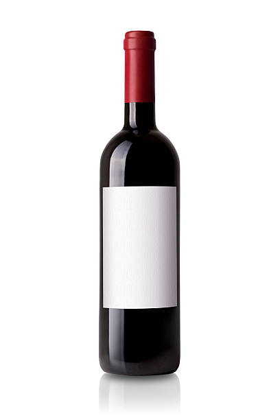 red wine bottle red wine bottle isolated on white background merlot grape stock pictures, royalty-free photos & images
