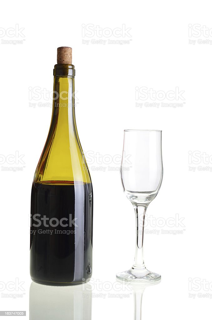 Red wine bottle with empty glass royalty-free stock photo