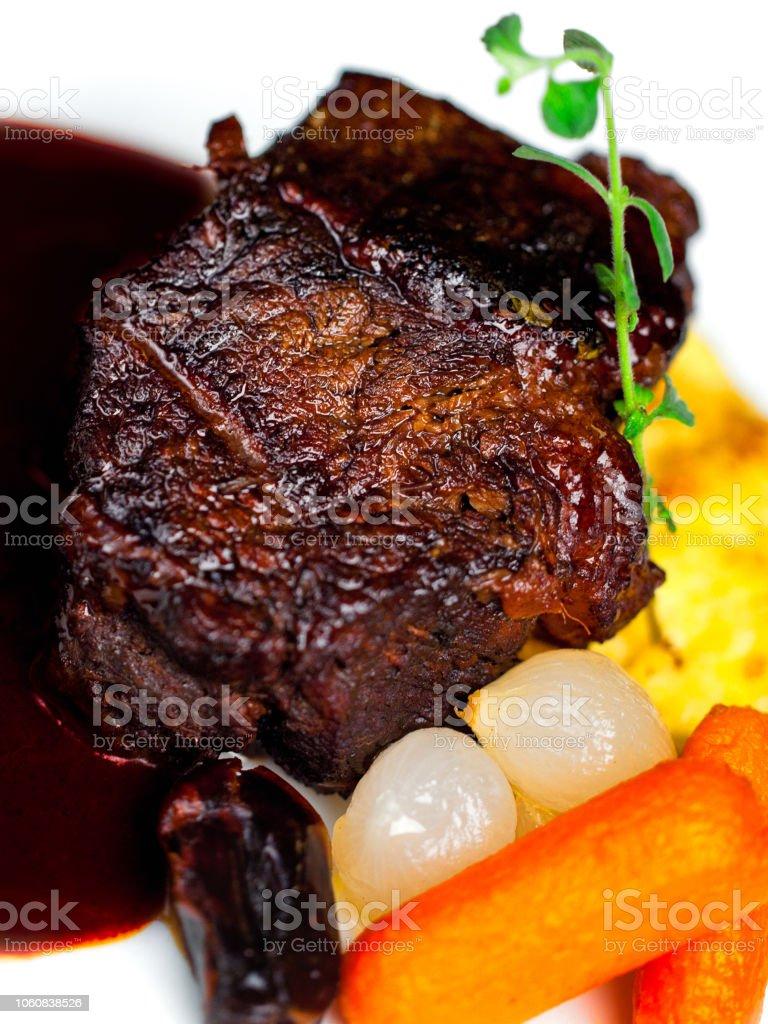 Red wine braised beef blade steak stock photo