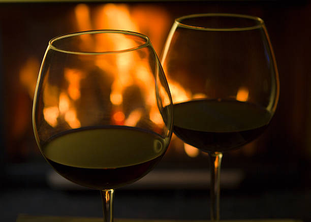 Red Wine by the Fire stock photo