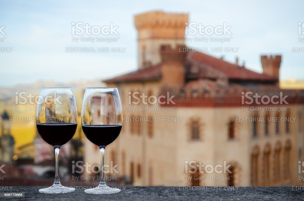 Red wine chalices with the castle of Barolo stock photo