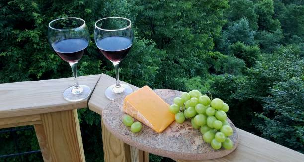 Red Wine, Cheddar Cheese and Grapes stock photo