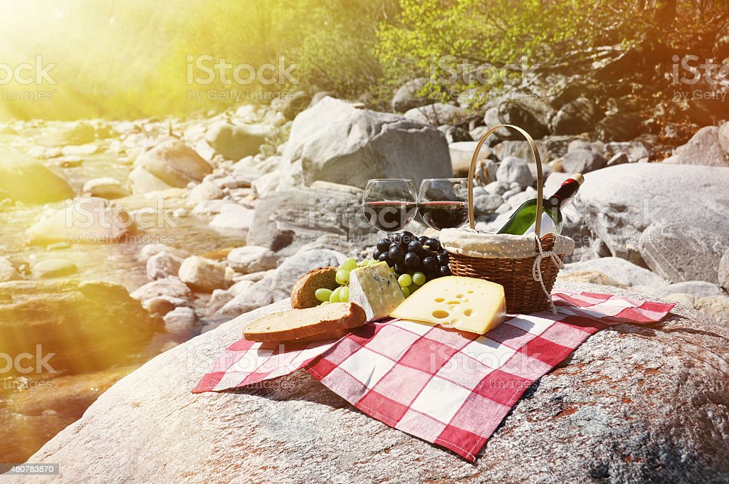 Red wine, cheese and grapes served at a picnic stock photo