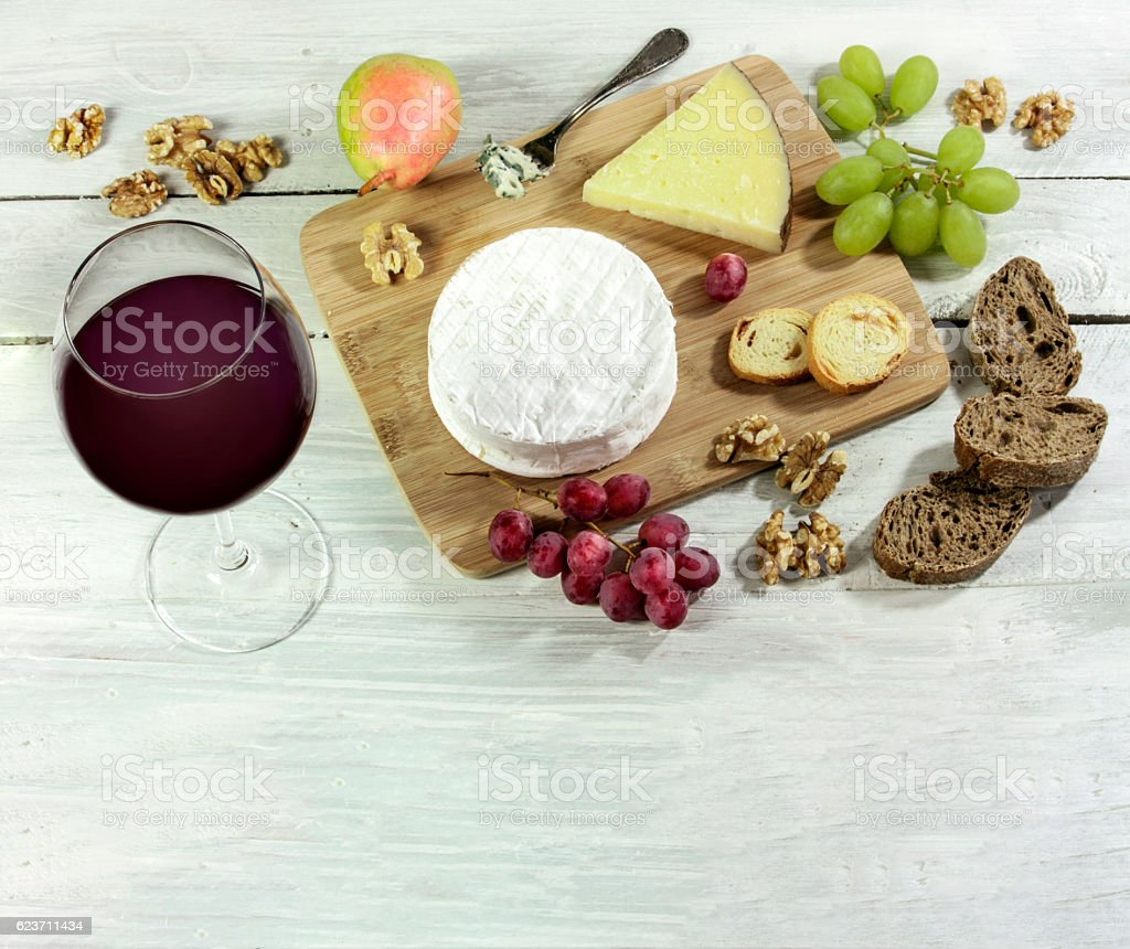 Red wine, cheese, grapes, nuts, with copyspace stock photo