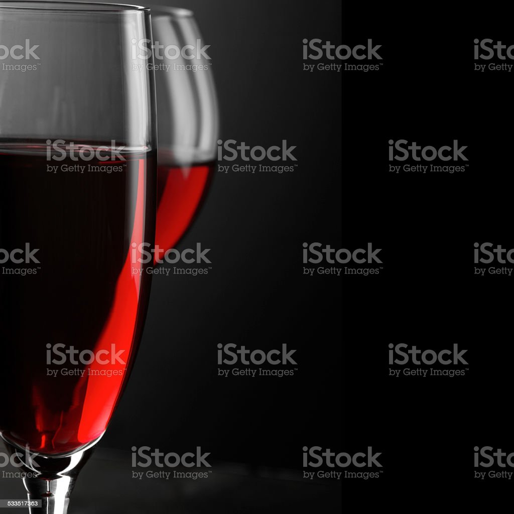 Red wine close-up Two glass of red wine close-up on black background. Soft focus, shallow DOF. 2015 Stock Photo