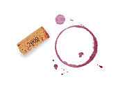 One red wine cork and dry circle ring stain of glass or bottle and blob drops isolated on white background